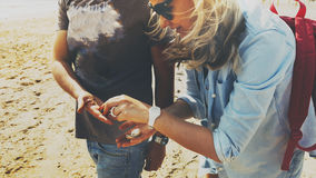 Young Man Helping Woman Collect Seashells Together Tourism Adventure Concept. Kuban, Russia royalty free stock image