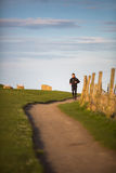 Young man on her evening jog Royalty Free Stock Photography