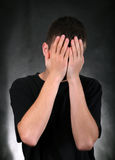 Young Man With Hidden Face Stock Photo
