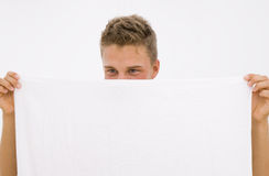 Young man hiding himself Stock Image