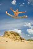 Young man in a high karate jump Royalty Free Stock Photo