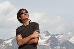 Young man high in the mountains Stock Photo