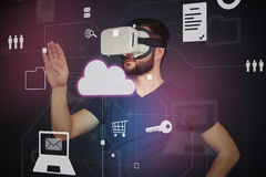 Young man in high tech VR-headset using interactive touch scree Royalty Free Stock Photography