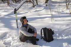 Young Man hiker in snowy forest take a rest during trekking. Winter leisure, sports and activity. Young Man hiker in snowy forest take a rest during trekking Stock Photography