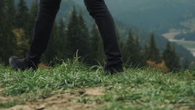 Young man hiker walking outdoors on background of mountain landscape. Outdoor activity. Lifestyle adventure. Back view, toning, 4K stock video