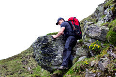 Young man hiking on difficult mountain trail Royalty Free Stock Photos
