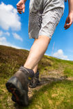 Young man hiking , going uphill Stock Image