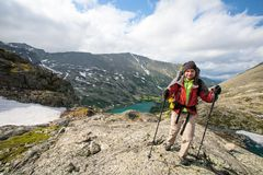 Young man is hiking in highlands of Altai mountains, Russia Stock Image