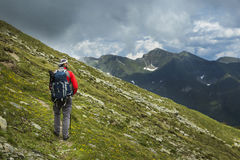 Young man hiking Stock Image