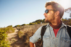 Young man hiking in nature Royalty Free Stock Photos