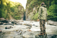 Young Man hiking outdoor Lifestyle Travel. Survival concept river and rocky mountains on background royalty free stock images