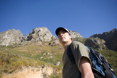 Young man hiking with rucksack, low angle view Stock Image