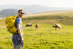 Young man hiking Stock Images