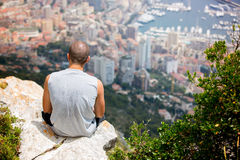 Young man on a hill above Monaco, contemplating the view Stock Images