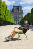 Young man hipster resting in the Tuileries Gardens in Paris, Fra. Young man hipster spring rests in the Tuileries Gardens in Paris, France Royalty Free Stock Photos