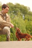 Young man and his adorable dachshund outdoor Stock Images