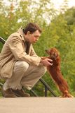 Young man and his adorable dachshund  outdoor Stock Photography