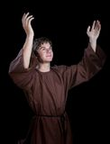 Young Man With his Arms Lifted in Praise Royalty Free Stock Photos