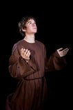 Young Man With his Arms Lifted in worship Stock Photos