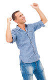 Young man with his arms raised in celebration Stock Images