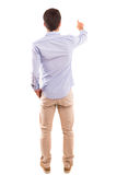 Young man. A young man with his back turned to camera, pointing to something Royalty Free Stock Photography