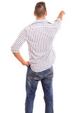 Young man. A young man with his back turned to camera, pointing to something royalty free stock image