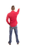 Young man. A young man with his back turned to camera, pointing to something Royalty Free Stock Photos