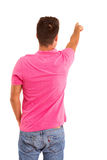 Young man. A young man with his back turned to camera, pointing to something Stock Image