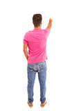 Young man. A young man with his back turned to camera, pointing to something stock photos