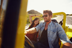 Young man with his beautiful girlfriend on a road trip Stock Image