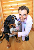 Young man with his bernese sennenhund dog Royalty Free Stock Photo
