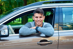 Young man in his car Stock Photography