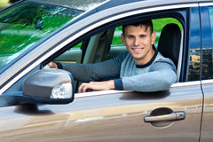Young man in his car Stock Image