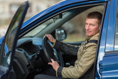 A young man in his car. Hobby. Royalty Free Stock Photos