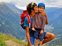 Young man with his child in mountains Royalty Free Stock Image