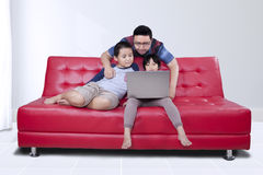 Young man and his children using laptop Royalty Free Stock Image
