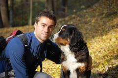Young man with his dog. Royalty Free Stock Photo