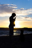 Young man with his dog in nature Royalty Free Stock Images