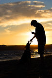 Young man with his dog in nature Royalty Free Stock Photography
