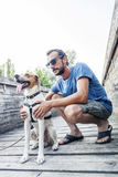 Young man with his dog in the park Royalty Free Stock Photo