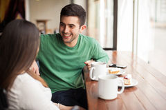 Young man with his girlfriend in a cafe royalty free stock photography