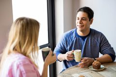 Young man with his girlfriend in a cafe royalty free stock images
