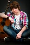 Young man and his guitar Royalty Free Stock Photos
