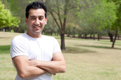 Young man with his hands folded in the park Stock Image