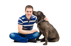 Young man and his licking dog. Isolated on white background Stock Photos