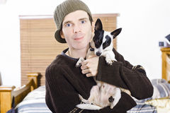 Young man with his little boy dog Stock Photos