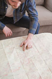 Young man. At his living room with a plaid shirt and a map Stock Photography