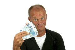 Young man with his money. On a white background Stock Photos