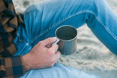 Young man tourist with his morning cup of coffee looking to the ocean view Stock Images