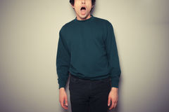 Young man with his mouth open. A young man is surprised and has his mouth open Royalty Free Stock Images